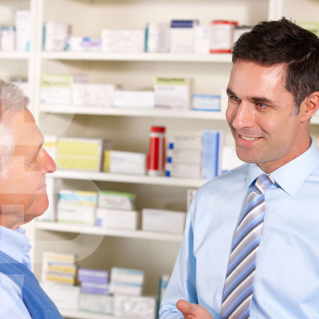 image of a pharmacist speaking to a customer as part of NMS service