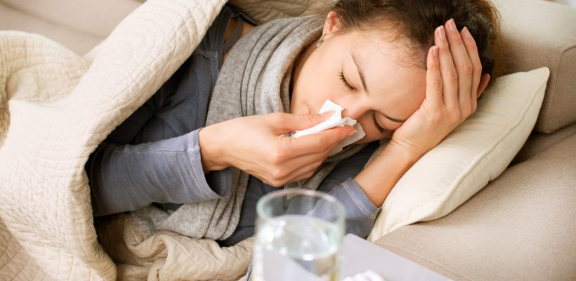 person in bed with flu