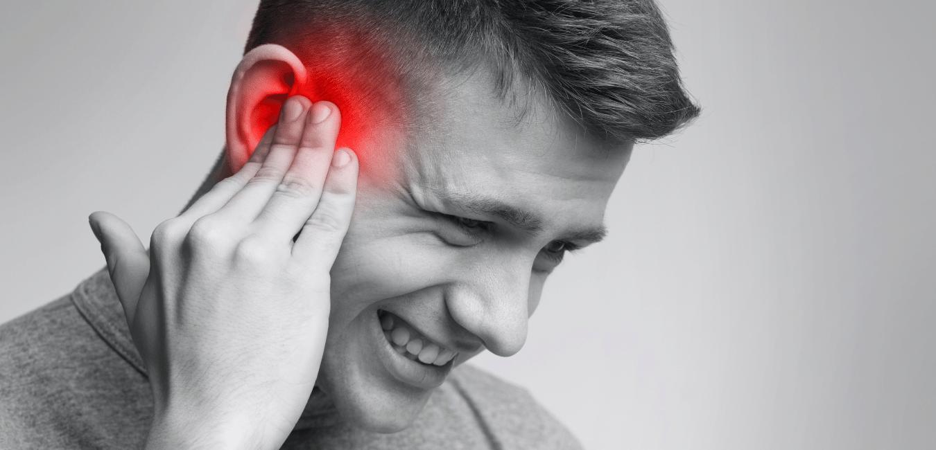 Man with ear ache